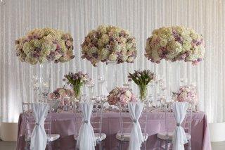 wedding-styled-shoot-inspiration-purple-linen-white-chair-drapery-tall-flower-arrangements-purple