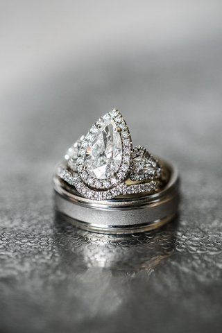 pear-shaped-diamond-three-stone-halo-engagement-ring-with-mens-wedding-band