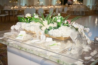 sweetheart-table-gold-box-filled-with-white-hydrangea-roses-orchids-tulips-greenery-floating