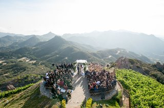 malibu-rocky-oaks-vineyard-estate-wedding-ceremony-on-helipad-overlooking-santa-monica-mountains