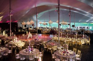 tented-reception-for-large-wedding-chandeliers-uplighting