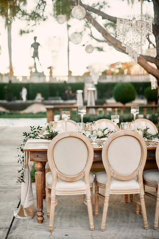 wedding-reception-with-light-wooden-chairs-with-ivory-ecru-cushions
