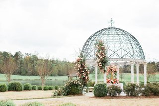2400-on-the-river-wedding-gazebo-with-white-columns-with-large-flower-arrangements