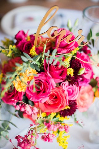 colorful-floral-arrangement-with-pink-red-yellow-flowers-and-greenery-gold-laser-cut-table-number