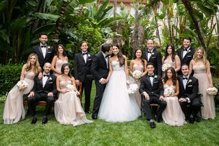 bride-in-monique-lhuillier-wedding-dress-groomsmen-in-tuxedos-bridesmaids-in-champagne-dresses