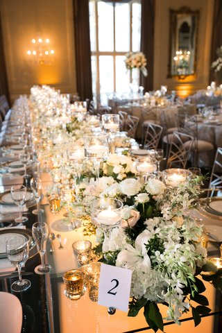 long-kings-table-with-chameleon-chairs-small-centerpieces-and-candles-form