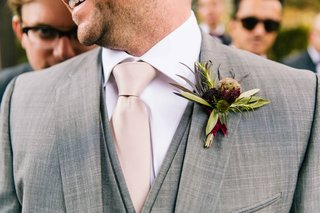 grooms-rustic-boutonniere-featuring-green-and-deep-purple-to-match-wine-color-scheme