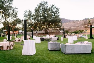 large-lounge-area-farmhouse-lawn-faux-wedding-party-styled-shoot-rustic-event-fairy-lights-tables