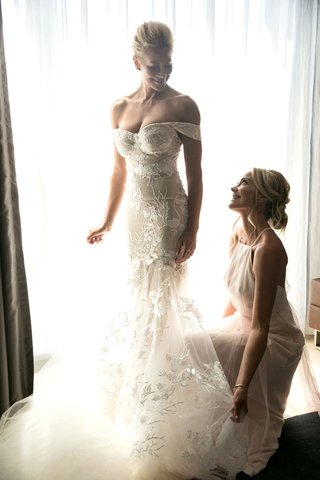actress-brittany-daniel-in-off-shoulder-form-fitting-wedding-dress-with-sister-cynthia-daniel