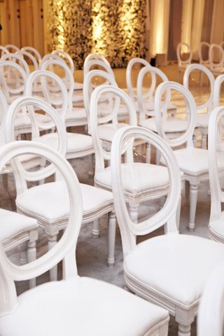 white-ceremony-chairs-with-clear-round-backs-and-plush-cushions