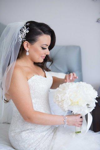 armenian-bride-with-flower-headpiece-bracelet-white-peony-bouquet-with-ribbon-teardrop-earrings