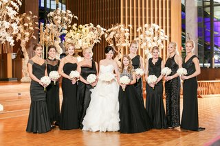 bride-in-lazaro-ball-gown-bridesmaids-in-mismatched-black-dresses-junior-bridesmaid