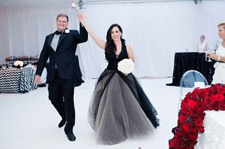 bride-in-black-vera-wang-dress-and-groom-in-black-suit