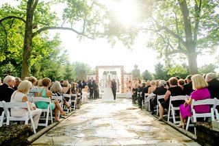 pretty-light-shining-on-outdoor-wedding-ceremony-pink-flowers-cincinnati-humidity-sunny-spring-june