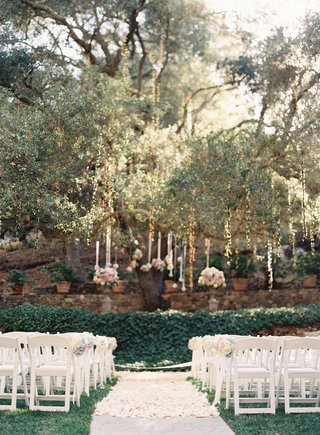 flower-petal-aisle-at-calamigos-ranch-under-tree-with-flower-arrangements-hanging-and-twinkle-lights