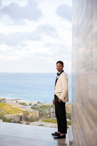 wedding-portrait-groom-at-cabo-resort-white-tuxedo-jacket-loafers-no-socks-black-pants