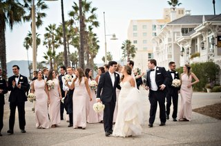 bridesmaids-in-light-pink-dresses-and-groomsmen-in-tuxedos-in-santa-monica-by-casa-del-mar-beachfron