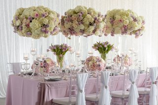wedding-inspiration-reception-shoot-tall-centerpieces-clear-chairs-white-sash-silver-tie-back-purple