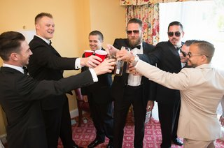 groom-in-armani-collezioni-groomsmen-cheers-their-drinks
