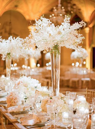 tall-fluted-vases-filled-with-cascading-white-orchids