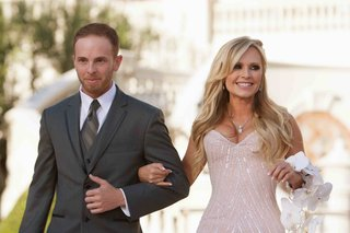 bride-walks-down-aisle-on-arm-of-her-oldest-son