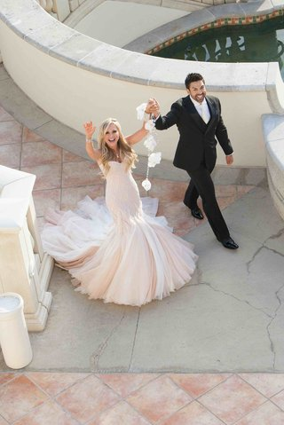 tamra-barney-and-eddie-judge-waving-to-camera-above-on-wedding-day