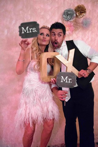 tamra-barney-and-eddie-judge-at-wedding-photobooth