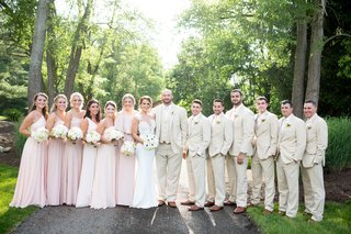 new-york-jets-brian-winters-wedding-bridesmaids-in-blush-groom-and-groomsmen-in-tan-khaki-suits