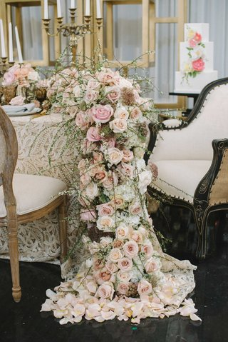 a-table-with-a-champagne-and-gold-concept-with-cascading-floral-table-runner-pink-flowers-greenery