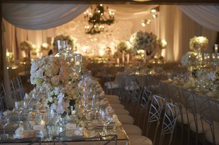 table-with-mirror-topped-with-neutral-centerpieces