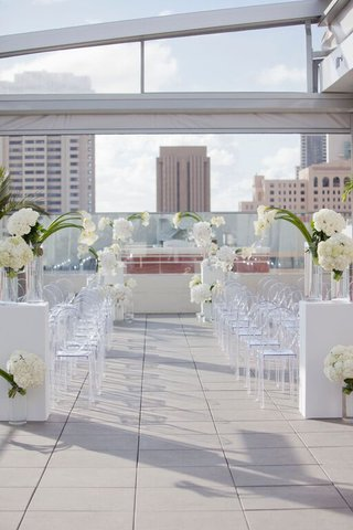 white-outdoor-wedding-ceremony-with-ghost-chairs-and-calla-lily-flowers