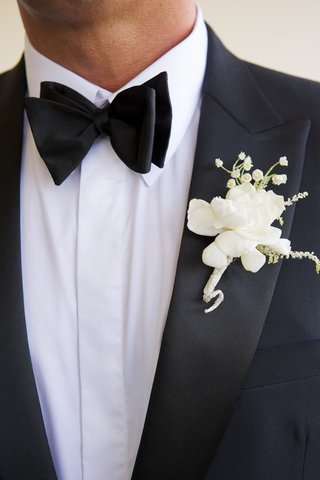 white-gardenia-groom-boutonniere-on-tuxedo-lapel