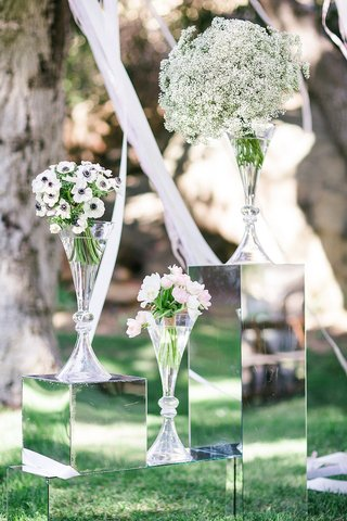 white-anemones-with-blue-centers-pink-and-ivory-tulips-babys-breath-in-glass-vases-at-outdoor-alt