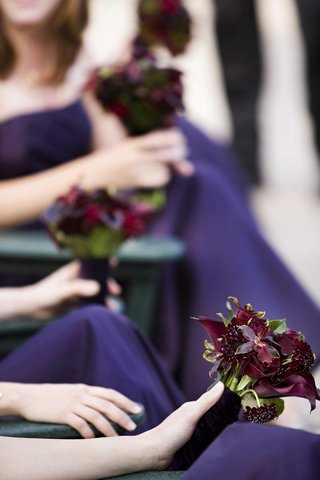 bridesmaids-in-amethyst-dresses-holding-nosegay