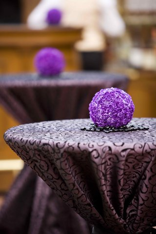 two-toned-purple-linens-and-carnation-pomander-ball