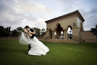 bride-and-groom-kiss-at-grand-del-mar-outside