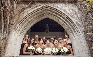 bride-and-bridesmaids-in-white-and-black-with-white-and-blush-bouquets-outside-chicago-church