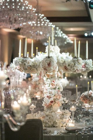 fake-candles-candelabra-covered-with-white-and-blush-roses