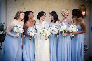bride-in-vintage-dress-and-bridesmaids-wearing-light-blue-dresses