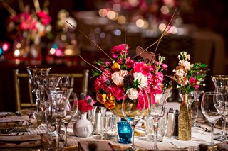 flower-arrangement-at-wedding-reception-with-gold-branches-pink-orange-and-white-flowers