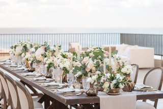 wedding-reception-centerpiece-outdoor-vase-candle-lisianthus-rose-foliage-french-chair-oval-back