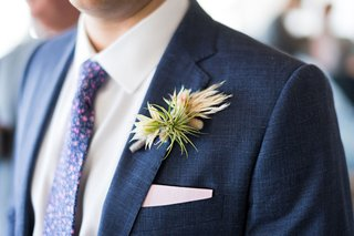 air-plant-wedding-boutonniere-on-navy-blue-suit-jacket-lapel-pattern-tie