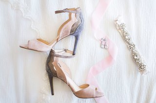 gray-pink-bridal-heels-by-jessica-simpson-garter-crystals-ribbon-on-white-bed-sheet-pre-wedding