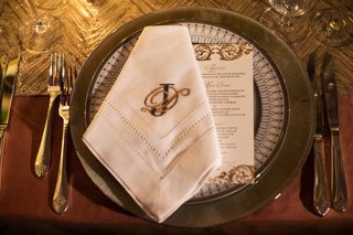 silver-and-gold-place-setting-and-china-plates