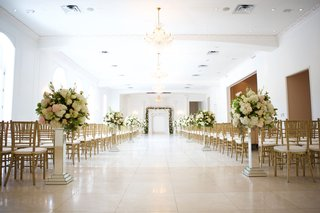 chateau-wedding-ceremony-white-ballroom-with-mirror-risers-and-pink-white-green-arrangements-gold