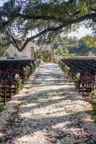 outdoor-wedding-ceremony-decorations-flower-petal-aisle-flower-markers-on-wood-chairs-floral-gates
