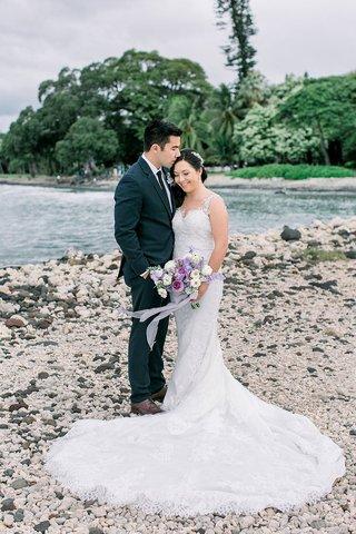 bride-and-groom-on-island-of-maui-in-hawaii-destination-wedding-couple-portrait-purple-flowers
