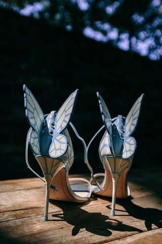 a-brides-light-blue-high-heels-that-feature-butterfly-wings-with-patterns-off-of-the-back