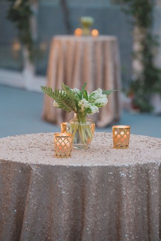 wedding-reception-cocktail-hour-small-tables-with-sequin-linens-gold-candle-votives-bud-vases-white