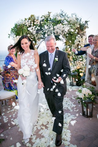 wedding-vow-renewal-in-santa-barbara-ocean-view-flower-petal-toss-by-guests-aisle
